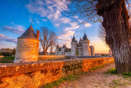 Sully Sur Loire, France - April 13, 2019: Famous medieval castle Sully sur Loire at sunset, Loire valley, France. The chateau dates from the end of the 14th century. Editöryel