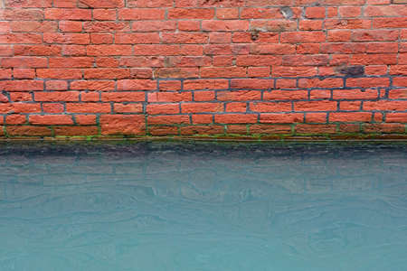 Canal in Venice with damp wall because of the high water. 写真素材