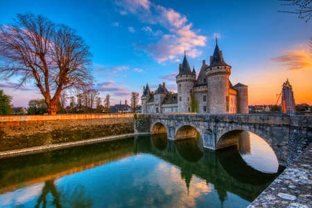 Sully Sur Loire, France - April 13, 2019: Famous medieval castle Sully sur Loire at sunset, Loire valley, France. The chateau of Sully sur Loire dates from the end of the 14th century.