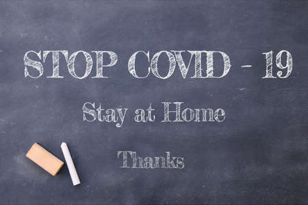 Coronavirus pandemic behaviour rules or health advice. Stop Covid-19, Stay at Home, Thanks chalkboard inscription. Stockfoto