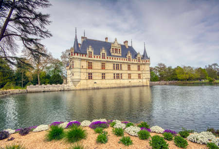 Azay le Rideau, France - April 17,2019: Chateau d'Azay-le-Rideau in Loire Valley, France. Castle of Azay-le-Rideau is one of the travel destinations in Europe. Scenic view of the French castle in spring.