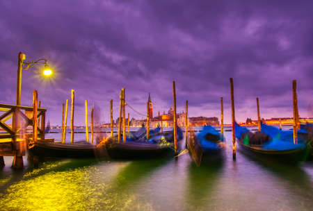 Gondolas moored by Saint Mark square on the Grand canal at dawn in Venice, Italy, Europe. Long exposure.