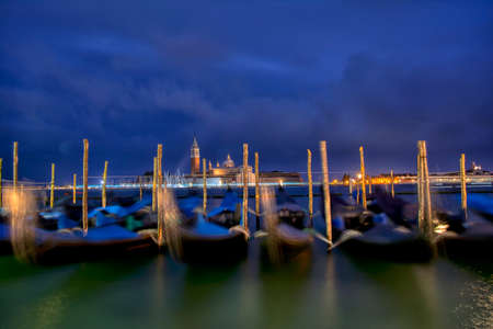 Gondolas moored by Saint Mark square on the Grand canals at dawn in Venice, Italy, Europe. Long exposure.
