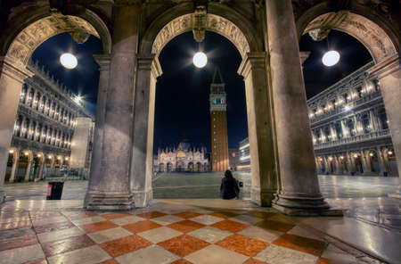 Venice, Italy - October 9, 2019: Saint Mark's square with campanile and basilica in Venice, Italy at night.