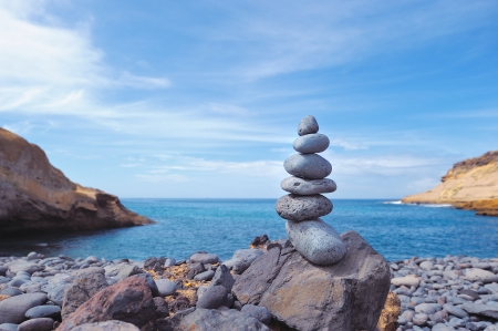 pyramidal: stacked of stones on the beach background