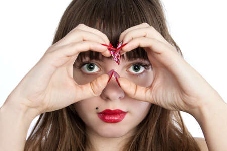 The Beautiful young woman making Hand Binoculars. Shot in studio over white. Stock Photo - 8926436