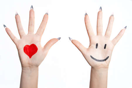 Painted heart and smile over the Hand. Isolated on white background