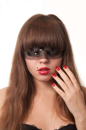 Beautiful young girl with her hand over her face and blindfold, over white background