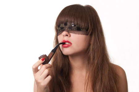 The beautiful girl blindfold and a pipe in lips Stock Photo - 10025166