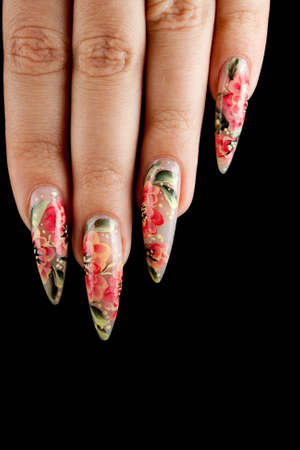 Girl fingers with beautiful drawing on nails photo