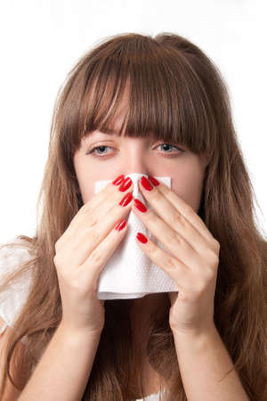 Girl blowing her nose-over white Stock Photo - 10792829