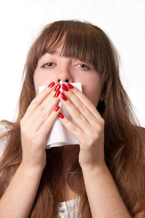 hanky: Girl blowing her nose-over white Stock Photo
