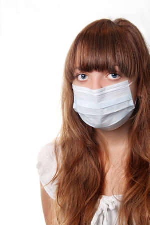 The girl in a medical mask on a white background photo