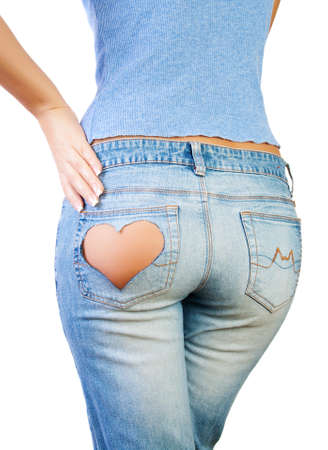 Girl in jeans with heart-shaped hole on the buttock, hand on hip photo