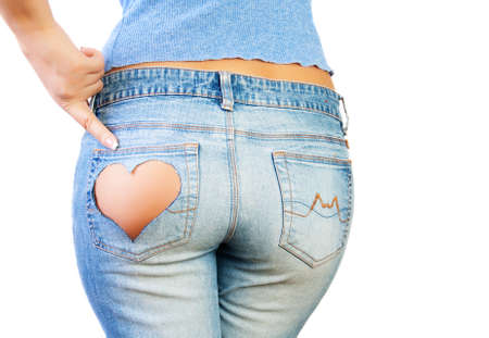 Girl in jeans with heart-shaped hole on the buttock, indicates the finger Stock Photo - 11372895