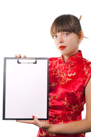 The beautiful girl holds a folder with a sheet of paper Stock Photo