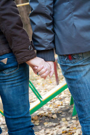 Closeup image of a two girls holding hands Stock Photo