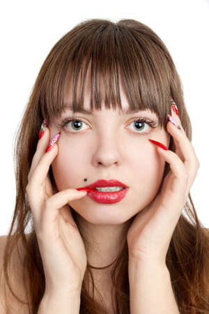 Beautiful young woman with long red nails, over her face, over white background photo