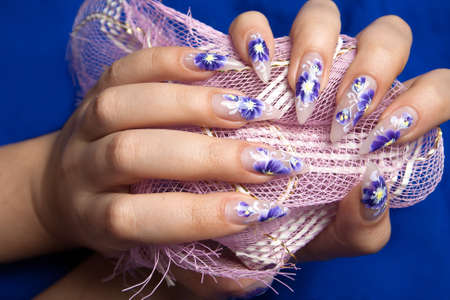 Two hands with beautiful nails photo