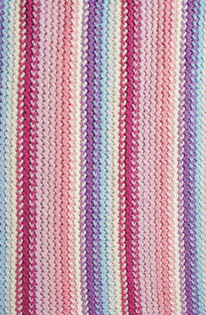 Knit woolen texture. Fabric multicolor background Stock Photo