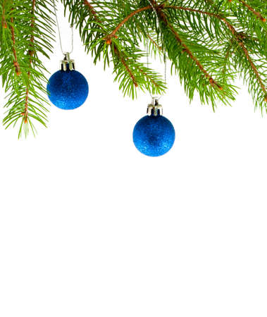 Two christmas balls and decoration on fir tree branch isolated on white