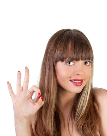 Happy smiling beautiful young woman showing okay gesture, isolated over white background