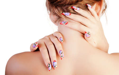 The young woman from a back, embraces itself a neck two hands with beautiful nails.