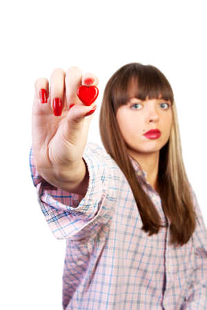 Young woman holding a red heart  in an outstretched arm Stock Photo