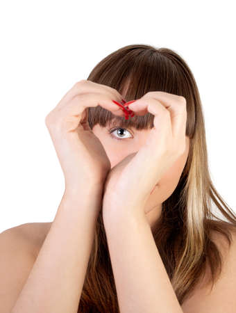 The girl looks through hands symbolizing heart photo