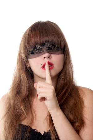 Shh. secret - Beautiful young girl with her finger over her mouth and  blindfold, over white background. Stock Photo - 11700653