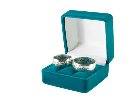 Wedding rings in an open gift box, on white background photo