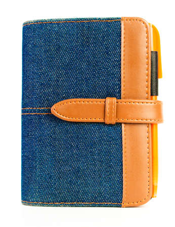 Blue denim notebook with orange pen, on white background Stock Photo