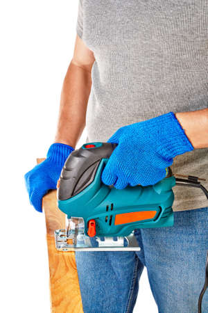 Man with electrical saw in hands, over white background Stock Photo