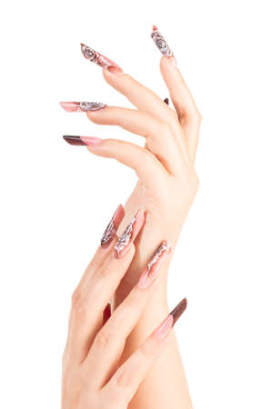 Two crossed hands with beautiful fingernails over white background