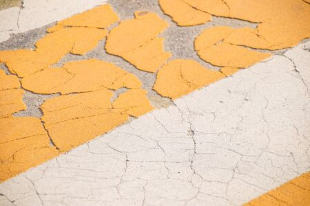 Grunge Road Markings For Pedestrians With Yellow And White Paints texture. Zdjęcie Seryjne
