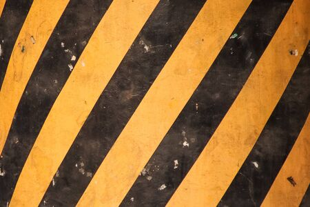 Grunge Road Markings For Pedestrians With Yellow And Black Paints texture.