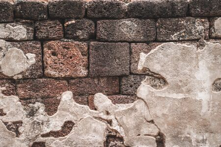 Colorful natural stone wall with cement texture background.