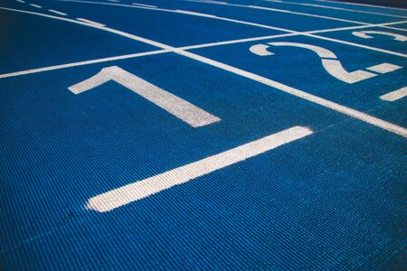 Numbered running track blue color. Starting position