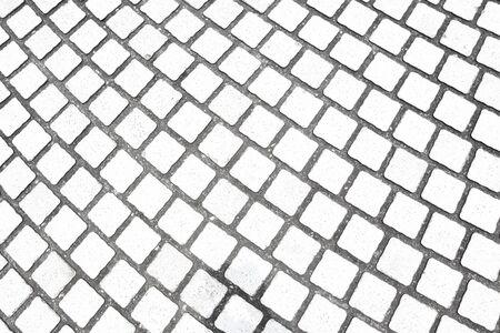 Stone pavement texture. Granite cobblestoned pavement background. Archivio Fotografico