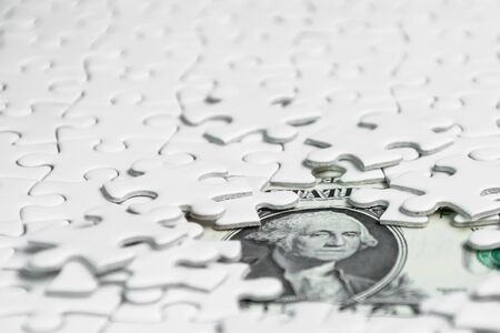 Missing jigsaw puzzle pieces on money dollar background, Business solution concept ,key for success