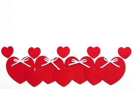 Valentine's day cut red paper heart with white background.