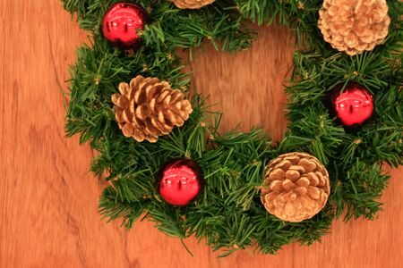 Close up christmas wreath on wooden background, soft focus Archivio Fotografico
