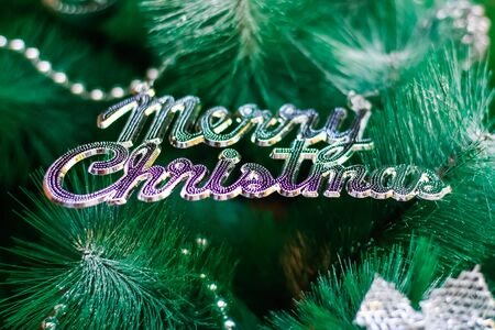 Decoration text merry christmas on christmas tree background Archivio Fotografico