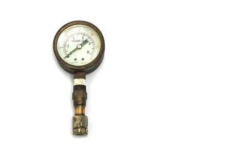 old and rusty pressure gauge isorated on white Background