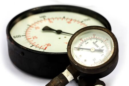 Close up old and rusty pressure gauge isorated on white Background
