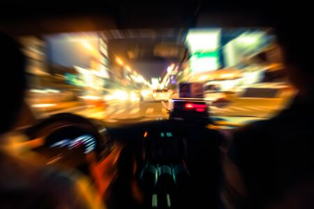 motion blur view inside taxi at night background