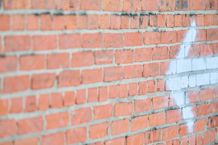 Brick wall texture background with arrow and space for writing Stock Photo