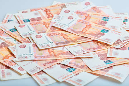A lot of russian money banknotes of roubles Stock Photo