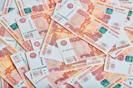 A lot of russian money banknotes of roubles, background