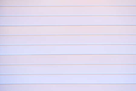 The texture of a plastic wall with horizontal stripes of white or lavender blush boards, background Stock Photo